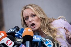 Adult film actress Stormy Daniels, whose real name is Stephanie Clifford, speaks to reporters as she exits the United States District Court Southern District of New York for a hearing related to Michael Cohen, President Trump's longtime personal attorney and confidante, April 16, 2018, in New York City. (Credit: Drew Angerer/Getty Images)