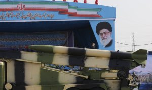 An Iranian military truck carries missiles past a portrait of Iran's Supreme Leader Ayatollah Ali Khamenei during a parade on the occasion of the country's annual army day on April 18, 2018 in Tehran. (Credit: ATTA KENARE/AFP/Getty Images)