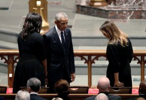 Former President Barack Obama and former first lady Michelle Obama greet first lady Melania Trump at St. Martin's Episcopal Church for a funeral service for former first lady Barbara Bush on April 21, 2018 in Houston, Texas. (Credit: David J. Phillip-Pool/Getty Images)