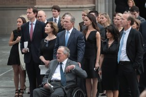 Former president George H.W. Bush and son, former president George W. Bush, watch with family as the coffin of former first lady Barbara Bush is placed in a hearse outside of St. Martin's Episcopal Church following her funeral service on April 21, 2018 in Houston, Texas. (Credit: Scott Olson/Getty Images)