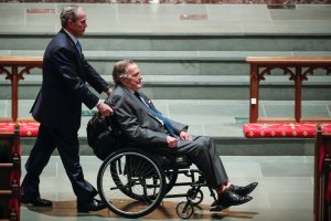 Former president George W. Bush wheels his father, former president George H.W. Bush into the church for the funeral for former first lady Barbara Bush at St. Martin's Episcopal Church on April 21, 2018 in Houston, Texas. (Credit: Brett Coomer - Pool/Getty Images)