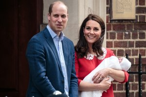 Prince William, Duke of Cambridge and Catherine, Duchess of Cambridge, pose for photographers with their newborn baby boy outside the Lindo Wing of St Mary's Hospital on April 23, 2018 in London. (Credit: Jack Taylor/Getty Images)