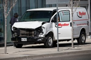 Police inspect a van suspected of being involved in a crash that injured multiple pedestrians on April 23, 2018 in Toronto, Canada. (Credit: Cole Burston/Getty Images)