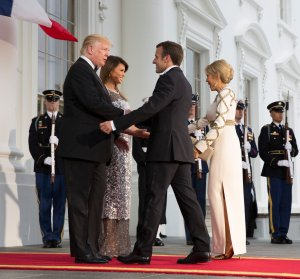 President Donald Trump and first lady Melania Trump greet French President Emmanuel Macron and French first lady Brigitte Macron before a State Dinner at the White House, April 24, 2018. (Credit: Chris Kleponis / Getty Images)