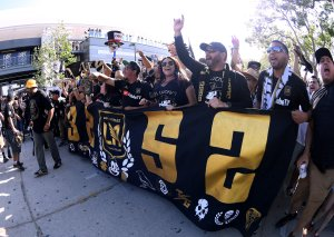 Fans gather at the Banc of California Stadium in Exposition Park before the inaugural home match of Los Angeles Football Club against the Seattle Sounders on April 29, 2018. (Credit: Harry How/Getty Images)