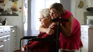 Margaret Wardlow hugs her mother Dolores McKeown, 97, in her McKeown's Cathedral City home. Wardlow was raped by the Golden State Killer in 1977, when she was 13. (Credit: Christina House / Los Angeles Times)