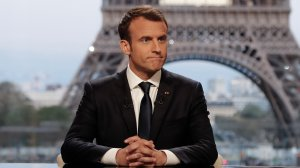French President Emmanuel Macron poses on the TV set before an interview with RMC-BFM and Mediapart French journalists at the Theatre national de Chaillot in Paris, on April 15, 2018, after the United States, Britain and France decided to launch air strikes in Syria in response to a suspected chemical weapons attack. (Credit: FRANCOIS GUILLOT/AFP/Getty Images)