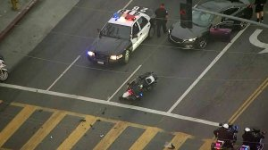 Authorities investigate a crash involving a motorcycle officer in North Hills on April 26, 2018. (Credit: KTLA)