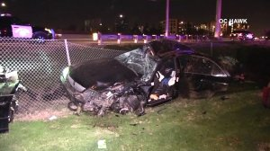 A car landed in a Motel 6 parking lot after flying off a freeway in Orange on April 8, 2018. (Credit: OC Hawk)