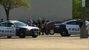 Dallas police respond to the scene where a man shot two police officers and a loss prevention officer at a Home Depot on April 24, 2018. (Credit: KTVT via CNN)