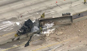 Crews respond to a big rig involved in a crash on the 405 Freeway on April 30, 2018. (Credit: KTLA)