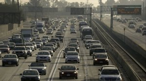 With congestion building in the toll lanes on the 110 and 10 freeways, Metro is ending the free access for commuters who drove alone in plug-in hybrids and electric vehicles. (Credit: Irfan Khan / Los Angeles Times)