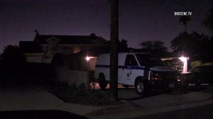 A Los Angeles County coroner's van sits outside a home where two women were found dead on April 23, 2018. (Credit: OnScene.TV)