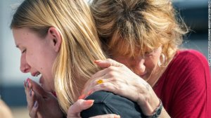 Santa Fe High School student Dakota Shrader is comforted by her mother Susan Davidson following a shooting at the school on Friday, May 18, 2018, in Santa Fe, Texas. Shrader said her friend was shot in the incident. (Credit: Stuart Villanueva/The Galveston County Daily News via AP)