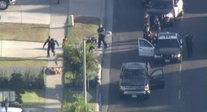 A man suspected of intentionally ramming a police vehicle in Santa Ana surrenders to police on May 17, 2018. (Credit: KTLA)