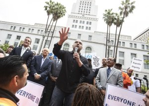 At a rally convened by L.A. City Council President Herb Wesson, homeless advocate Mel Tillekeratne speaks in support of temporary housing for the homeless in Los Angeles on May 18, 2018. (Credit: Brian van der Brug / Los Angeles Times)