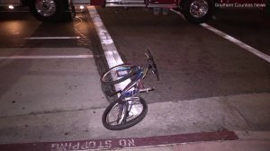A bicycle is seen laying on the street after a deadly hit-and-run crash in Compton on May 20, 2018. (Credit: Southern Counties News)