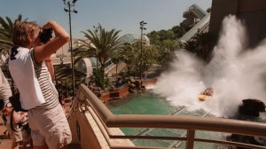 Visitors to Universal Studios Hollywood watch as riders of Jurassic Park -- The Ride splash down the final descent. A study found that the most expensive theme park to visit in the country is Universal Studios Hollywood. (Credit: Richard Derk / Los Angeles Times)