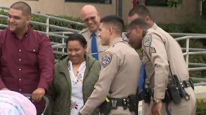 CHP officers reunite with the Lopez family on May 18, 2018. (Credit: KTLA)