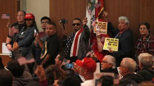 Opponents and supporters of California's Senate Bill 54 crowded the Costa Mesa City Council meeting on May 1, 2018. (Credit: Kevin Chang / Daily Pilot)
