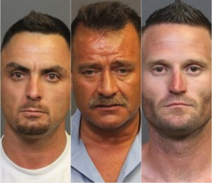 David Len Mcafee, left, Norman Michael Powers, center, and Brian Jay Bishop, right, are shown in booking photos released by the Costa Mesa Police Department on May 29, 2018.