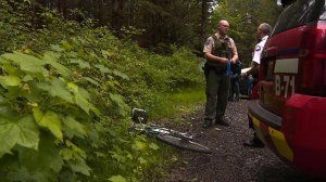 Authorities investigate after a cougar killed a mountain biker and injured another in Washington state on May 19, 2018. (Credit: CNN)