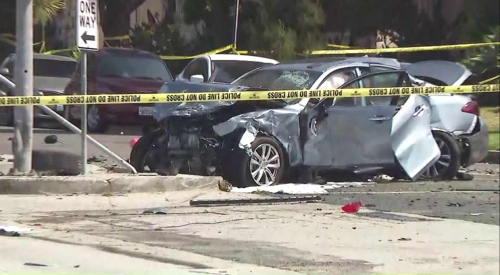 One of the vehicles involved in the crash sheared off a street sign at the scene on May 10, 2018. (Credit: KTLA)