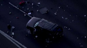 An SUV is surrounded by debris after it was involved in a crash with a California Highway Patrol officer on the 101 Freeway in Camarillo, May 10, 2018. (Credit: KTLA)