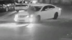 A still from surveillance video released by Downey police shows a security guard being run over in the parking lot of a Mexican restaurant on May 17, 2018.