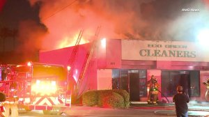 A fire rips through a strip mall in South Los Angeles on May 3, 2018. (Credit: RMG News)
