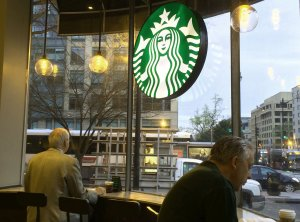 Patrons have morning coffee at a Starbucks in Washington, D.C on March 23, 2016. (Credit: Karen Bleier/AFP/Getty Images)