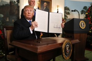 U.S. President Donald Trump holds up a proclamation that the U.S. government will formally recognize Jerusalem as the capital of Israel after signing the document in the Diplomatic Reception Room at the White House on December 6, 2017, in Washington, D.C. (Credit: Chip Somodevilla/Getty Images)