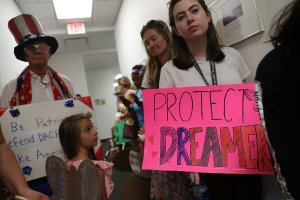 Lily Logsdon, right, joins other activists in front of the office of Sen. Bill Nelson, D-Fl, to ask him to help recipients of the Deferred Action for Childhood Arrivals on Feb. 2, 2018 in West Palm Beach, Florida. (Credit: Joe Raedle/Getty Images)