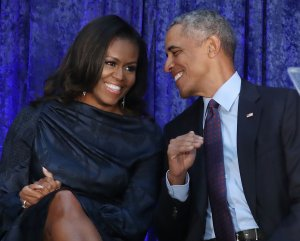 Former U.S. President Barack Obama and first lady Michelle Obama participate in the unveiling of their official portraits during a ceremony at the Smithsonian's National Portrait Gallery, on Feb. 12, 2018. (Credit: Mark Wilson/Getty Images)