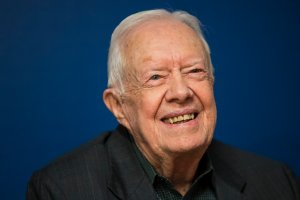 "Former U.S. President Jimmy Carter smiles during a book signing event for his new book ""Faith: A Journey For All"" at Barnes & Noble bookstore in Midtown Manhattan, March 26, 2018, in New York City. (Credit: Drew Angerer/Getty Images)"