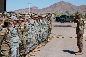 Members of the Arizona National Guard listen to instructions on April 9, 2018, at the Papago Park Military Reservation in Phoenix. (Credit: CAITLIN O'HARA/AFP/Getty Images)
