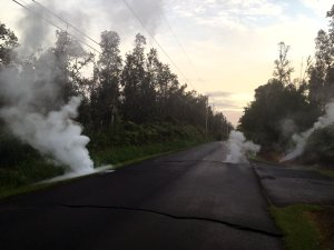 In this handout photo provided by the U.S. Geological Survey, a fissure produces steam from a street after the eruption of Hawaii's Kilauea volcano on May 4, 2018, in the Leilani Estates subdivision near Pahoa.