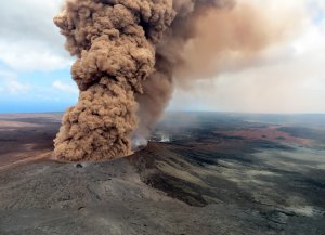 In this handout photo provided by the U.S. Geological Survey, a column of robust, reddish-brown ash plume occurred after a magnitude 6.9 South Flank following the eruption of Hawaii's Kilauea volcano on May 4, 2018, in the Leilani Estates subdivision near Pahoa.