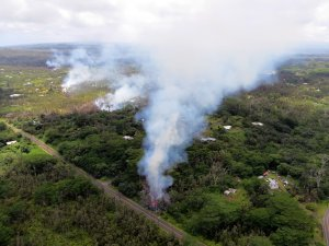 In this handout photo provided by the U.S. Geological Survey, a fissure produces lava after the eruption of Hawaii's Kilauea volcano on May 4, 2018, in the Leilani Estates subdivision near Pahoa.