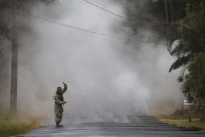 U.S. Army National Guard First Lt. Aaron Hew Len takes measurements for sulfur dioxide gas at volcanic fissures in the Leilani Estates neighborhood in the aftermath of eruptions from the Kilauea volcano on Hawaii's Big Island on May 8, 2018 in Pahoa, Hawaii. (Credit: Mario Tama/Getty Images)