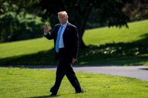 Donald Trump waves to the media on his way from the Oval Office to Marine One on May 15, 2018. (Credit: Pete Marovich-Pool/Getty Images)