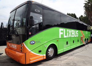 A bus is parked at the Los Angeles launch of the German bus company FlixBus on May 15, 2018. (Credit: Frederick M. Brown / Getty Images)