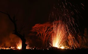 Lava is blurred as it erupts from a Kilauea volcano fissure on Hawaii's Big Island on May 17, 2018. (Credit: Mario Tama/Getty Images)
