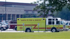 Emergency crews stage in the parking lot of Santa Fe High School where at least 10 students were killed on May 18, 2018 in Santa Fe, Texas. (Credit: Bob Levey/Getty Images)