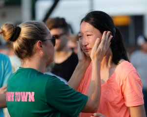 Friends and family attend a vigil held at the First Bank in Santa Fe for the victims of a shooting incident at Santa Fe High School, where a shooter killed at least 10 students on May 18, 2018, in Santa Fe, Texas. (Credit: Bob Levey / Getty Images)