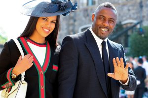 British actor Idris Elba arrives with Sabrina Dhowre for the wedding ceremony of Britain's Prince Harry, Duke of Sussex and US actress Meghan Markle at St George's Chapel, Windsor Castle, in Windsor, on May 19, 2018. (Credit: GARETH FULLER/AFP/Getty Images)