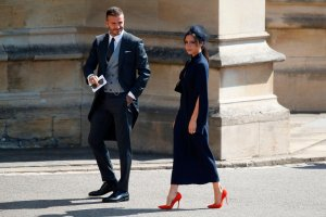 David and Victoria Beckham arrive for the wedding ceremony of Britain's Prince Harry, Duke of Sussex and US actress Meghan Markle at St George's Chapel, Windsor Castle, in Windsor, on May 19, 2018. (Credit: ODD ANDERSEN/AFP/Getty Images)