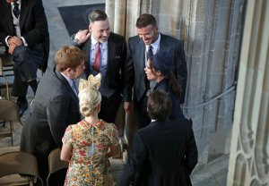 : David and Victoria Beckham (right) talk with Sir Elton John and David Furnish (left) and Sofia Wellesley and James Blunt (foreground) as they arrive in St George's Chapel at Windsor Castle for the wedding of Prince Harry to Meghan Markle on May 19, 2018 in Windsor, England. (Credit: Danny Lawson - WPA Pool/Getty Images)