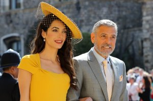 George and Amal Clooney arrive for the wedding ceremony of Britain's Prince Harry, Duke of Sussex and US actress Meghan Markle at St George's Chapel, Windsor Castle, in Windsor, on May 19, 2018. (Credit: ODD ANDERSEN/AFP/Getty Images)