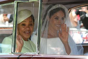 Meghan Markle and her mother, Doria Ragland, arrive for her wedding ceremony to marry Britain's Prince Harry, Duke of Sussex, at St George's Chapel, Windsor Castle, in Windsor, on May 19, 2018. (Credit: OLI SCARFF/AFP/Getty Images)